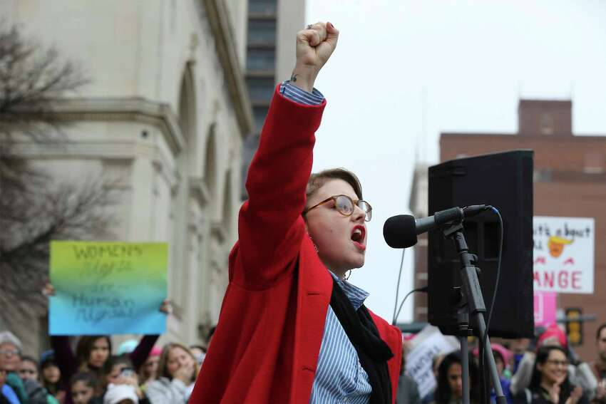 Performance artist Jessica Tilton Zertuche raises her fist while reciting her poetry of empowerment to about 500 people according to organizers gathered at Main Plaza to take part in the second annual Women's Rally on Saturday, Jan. 20, 2018. The message of the event hosted by TX23 Indivisible, was clear and decisive as speaker after speaker implored those in attendance that women's voices were not be silenced and to vote in upcoming elections.