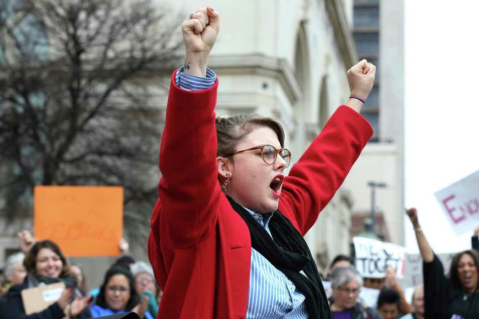 "Performance artist Jessica Tilton Zertuche raises her arms while reciting her poetry of empowerment to about 500 people according to organizers gathered at Main Plaza to take part in the second annual Women's Rally on Saturday, Jan. 20, 2018. The message of the event hosted by TX23 Indivisible, was clear and decisive as speaker after speaker implored those in attendance that women's voices were not be silenced and to vote in upcoming elections. ""When women vote, we win,"" said Cassandra Littlejohn, Bexar County Democratic Party Political Director. Toward the end of the two-hour rally, a brief march around Main Plaza came together as the event concluded."