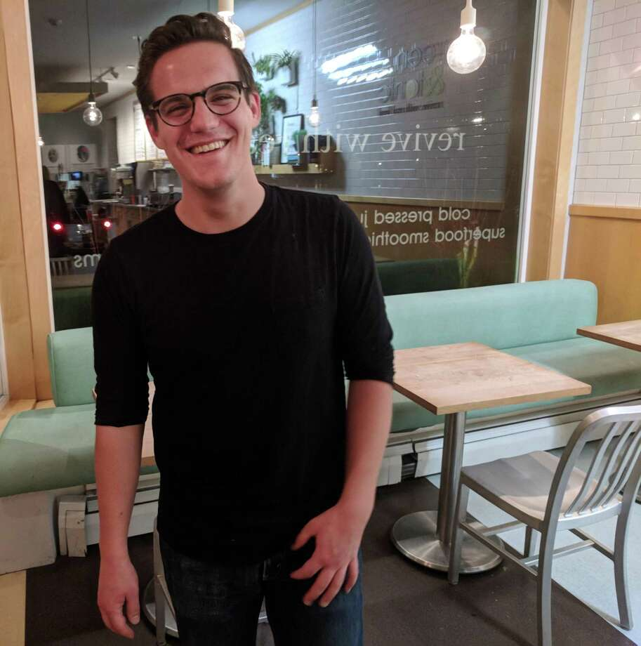 Ben Stein, a 23-year-old studio composition major at Purchase College, lives in Riverside and is working at Green and Tonic during his winter break. He hopes to become a great musician. Photo: Jennifer Turiano / Hearst CT Media