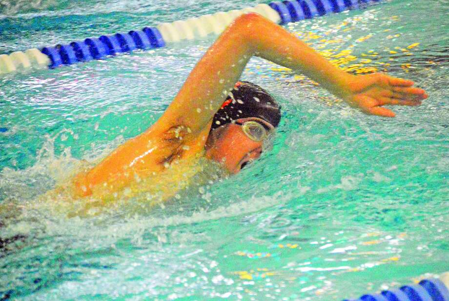 Edwardsville's Trent Sholl competes in the 500-yard freestyle event during Saturday's dual meet against Chatham Glenwood inside the Chuck Fruit Aquatic Center.