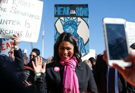 San Francisco Acting Mayor London Breed waves to supporters while greeting attendees of the Women's March and rally at Civic Center Plaza Saturday, Jan. 20, 2018 in San Francisco, Calif.