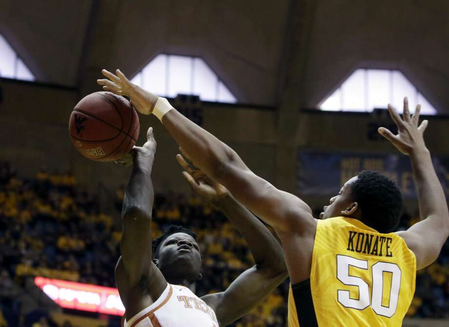 West Virginia forward Sagaba Konate (50) blocks Texas forward Mohamed Bamba (4) during the first half of an NCAA college basketball game Saturday, Jan. 20, 2018, in Morgantown, W.Va. (AP Photo/Raymond Thompson) Photo: Ray Thompson/Associated Press