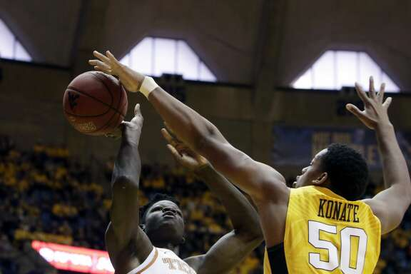 West Virginia forward Sagaba Konate (50) blocks Texas forward Mohamed Bamba (4) during the first half of an NCAA college basketball game Saturday, Jan. 20, 2018, in Morgantown, W.Va. (AP Photo/Raymond Thompson)