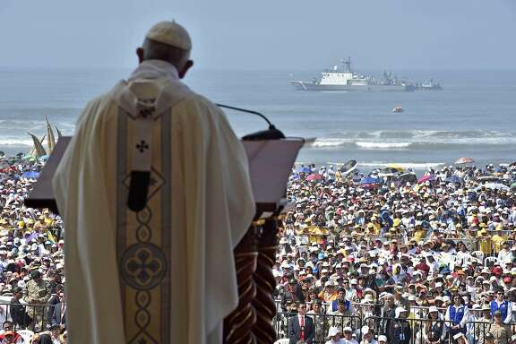 """TOPSHOT - Pope Francis officiates an open-air mass at the beach resort town of Huanchaco, northwest of the Peruvian city of Trujillo, on January 20, 2018.   The mass takes place on a wide swathe of beach able to accommodate 500,000 people, in the historic town of Huanchaco popular with surfers and known for its distinctive reed watercraft known as """"caballitos de totora."""" / AFP PHOTO / OSSERVATORE ROMANO / HO / RESTRICTED TO EDITORIAL USE - MANDATORY CREDIT """"AFP PHOTO / OSSERVATORE ROMANO"""" - NO MARKETING NO ADVERTISING CAMPAIGNS - DISTRIBUTED AS A SERVICE TO CLIENTS  HO/AFP/Getty Images"""