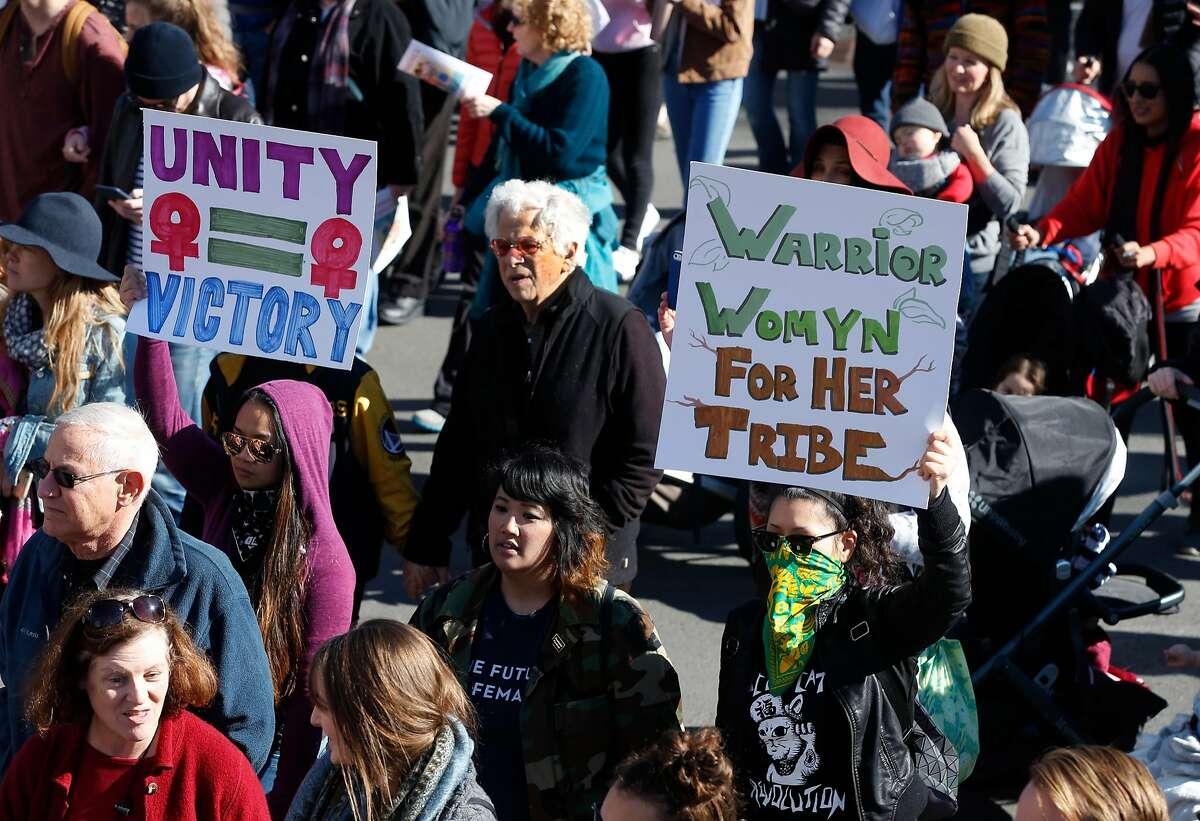 Thousands walk on 14th Street towards Frank Ogawa Plaza in the Women's March and rally in Oakland, Calif. on Saturday, Jan. 20, 2018.