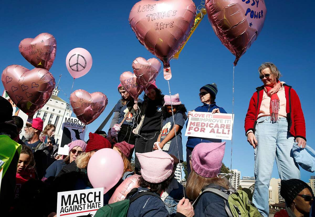 Participants gather at the Lake Merritt Amphitheater for a rally before the Women's March in Oakland, Calif. on Saturday, Jan. 20, 2018.