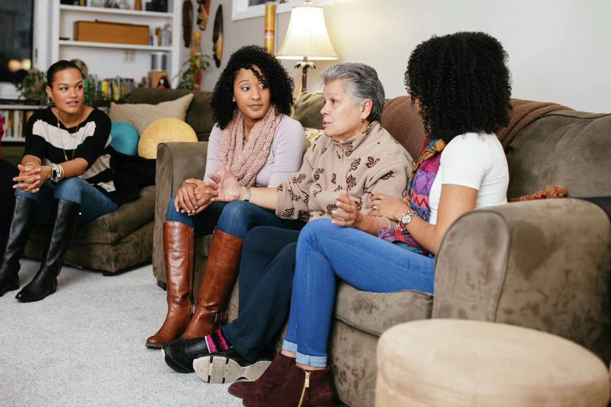 From left, Yari Ijeh, Maria Santos, Carmen Maria Duran and Dina Santos at Ijeh's home in New Haven on Saturday.The Santos sisters, natives of Cape Verde, lived with Duran and her family in Bridgeport for several years when she was their foster mother.
