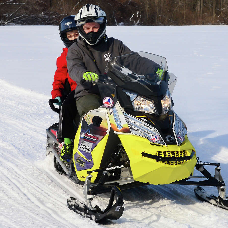 Ten-year-old William Kelly, left, of Greenwich gets a ride along on a NY Snowmobiling Association training sled behind Lincoln Mountain snowmobile club VP Daniel Leerkes during the Take a Friend Snowmobiling event at Hudson Crossing Park Saturday Jan. 20, 2018 in Schuylerville, NY.  (John Carl D'Annibale/Times Union) Photo: John Carl D'Annibale / 20042599A