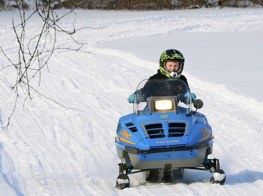 Safety course certified, Nicholas Campbell, 11, of Greenwich takes his snowmobile around a track during the Take a Friend Snowmobiling event at Hudson Crossing Park Saturday Jan. 20, 2018 in Schuylerville, NY.  (John Carl D'Annibale/Times Union) Photo: John Carl D'Annibale / 20042599A