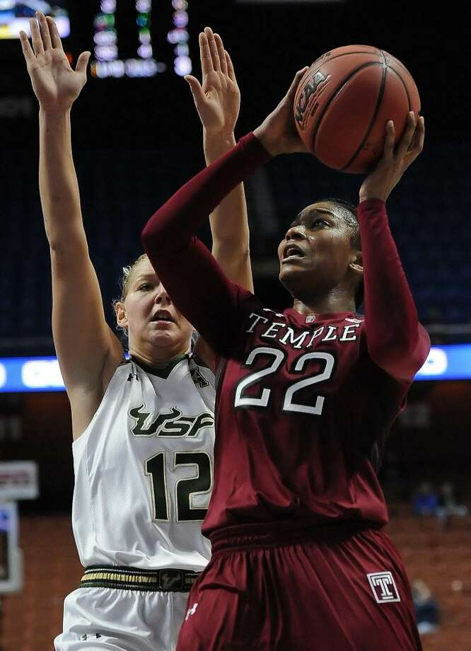Temple's Tanaya Atkinson, right, shoots as South Florida's Maria Jespersen defends during an American Athletic Conference tournament semifinal game at Mohegan Sun Arena on March 6, 2016 in Uncasville. Photo: Jessica Hill / Associated Press / FR125654 AP