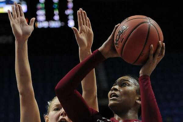Temple's Tanaya Atkinson, right, shoots as South Florida's Maria Jespersen defends during an American Athletic Conference tournament semifinal game at Mohegan Sun Arena on March 6, 2016 in Uncasville.