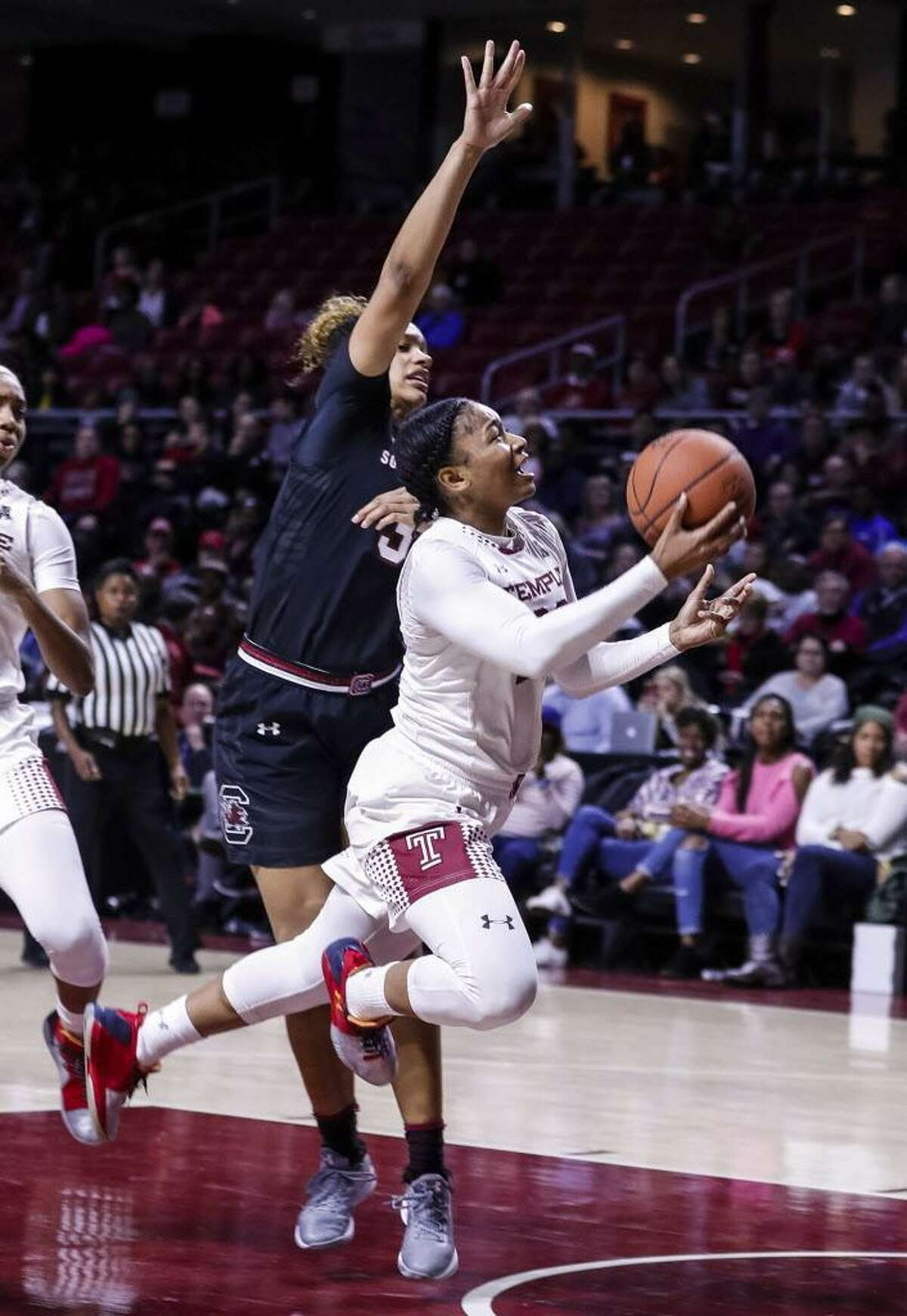 Temple's Tanaya Atkinson, right, goes up for the shot as she tries to get past South Carolina's Alexis Jennings during a Dec. 21 game in Philadelphia.