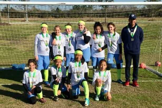 The Pearland Rise girls select soccer team took second place at the 2018 TAAF Winter Games tournament at Hickory Slough Sports Complex on Jan. 14. Team members are (front row) Caden Sparks, Ashley Parkinson, Kaelynn Pablo, Michelle Chen (second row) Peyton Goldenberg, Hayleigh Evans, Savannah Epting, Ava Mayhew, Sophia Castillo, Ava Curtner and coach Omar Villatoro. Not pictured are Emma Norwood and Caraleigh Hogue.