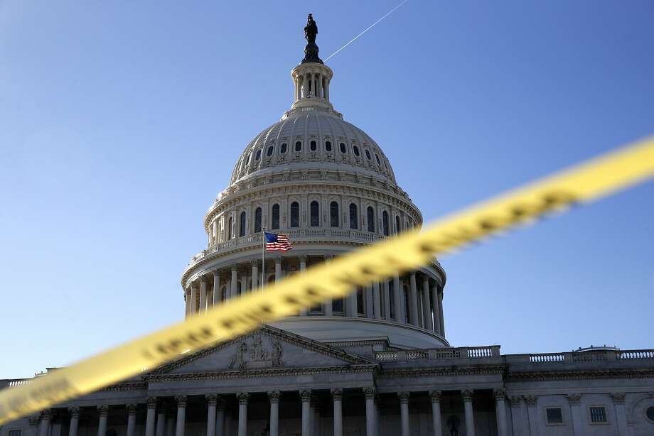 Police tape marks a secured area of the U.S. Capitol. Photo: Jacquelyn Martin, Associated Press