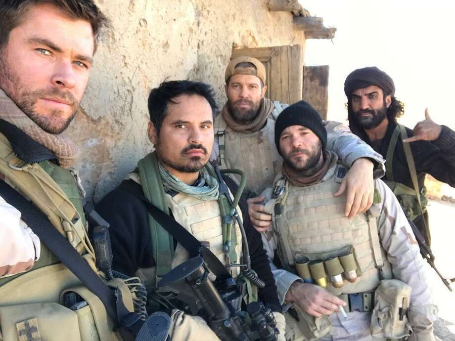 "Michael Pena, Geoff Stults, Chris Hemsworth, and Fahim Fazli in ""12 Strong"" (2018)"