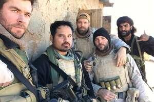"Michael Pena, Geoff Stults, Chris Hemsworth, and Fahim Fazli in ""12 Strong"" (2018)"