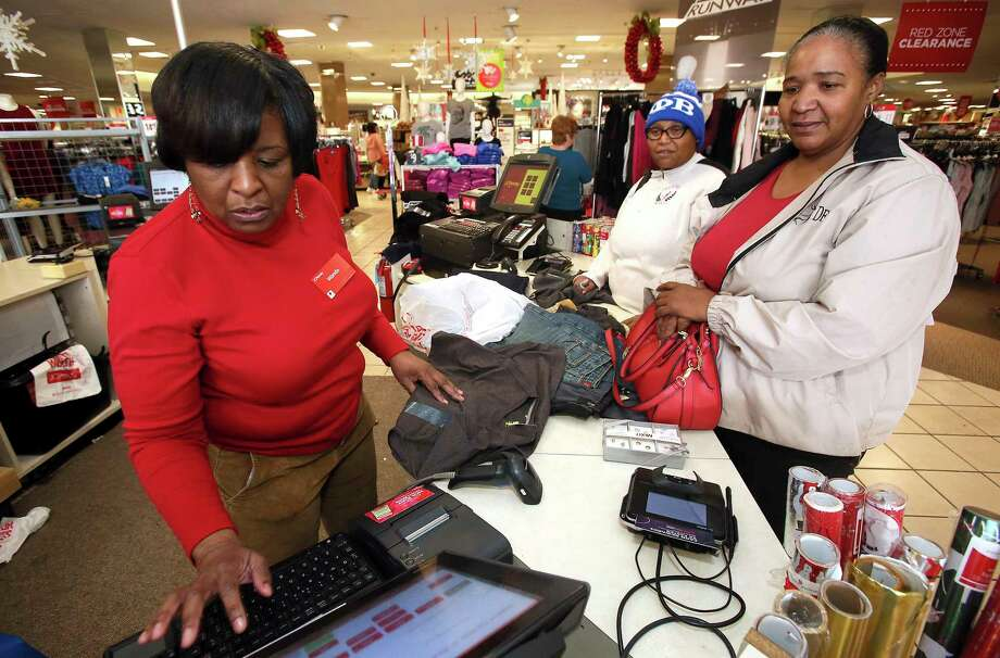 In this Tuesday, Dec. 26, 2017, file photo, J.C. Penney sales associate Wanda Cofield, left, assists Cynthia Putney, right, and Linda Pierce with returns and exchanges at the store, at Golden East Crossing mall in Rocky Mount, N.C. With the holiday season over, some shoppers are still wondering what to do with the unwanted gifts still hanging around. Shoppers have options, including swapping and selling online. (Alan Campbell/Rocky Mount Telegram via AP, File) Photo: Alan Campbell / Rocky Mount Telegram