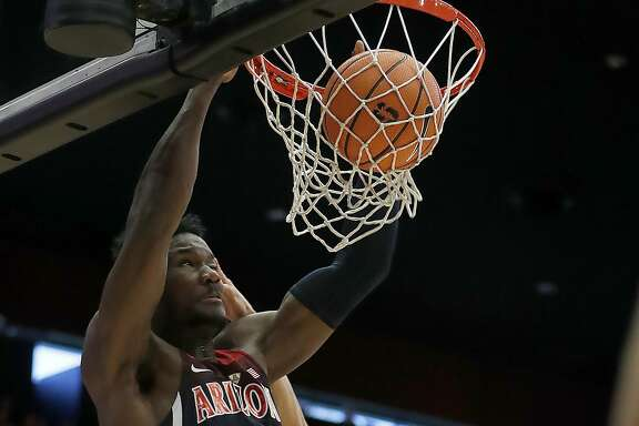 Arizona forward Deandre Ayton (13) dunks against Stanford center Josh Sharma (20) during the first half of an NCAA college basketball game Saturday, Jan. 20, 2018, in Stanford, Calif. (AP Photo/Tony Avelar)