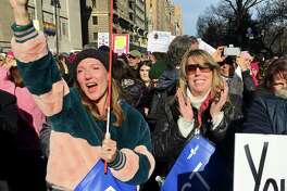 Darcy Hicks, left, of Westport, and Laura Totten, of Stamford, react to a speech by Whoopi Goldberg in New York. Hicks founded DefenDemocracy of Connecticut, a political action group, after the 2017 Women's March.