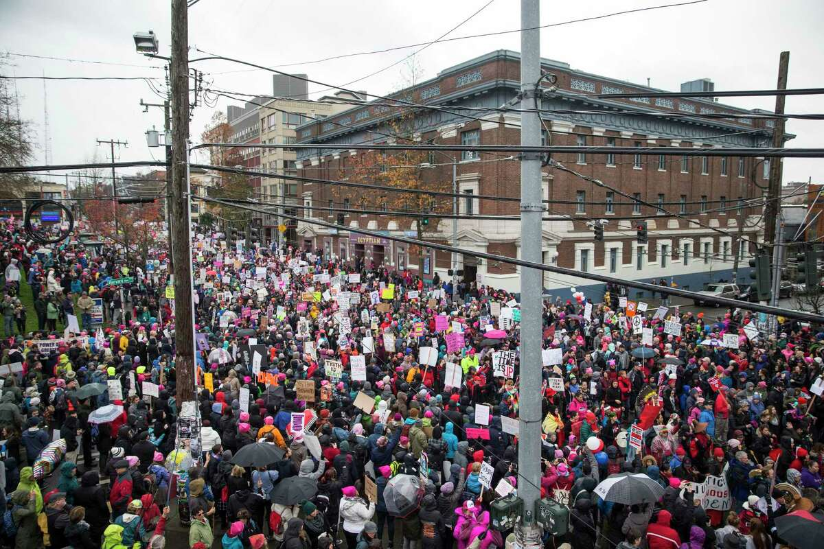 The intersection of Harvard and Pine is filled with thousands as the Seattle's Women's March 2.0 gets started on Saturday, Jan. 20, 2018.