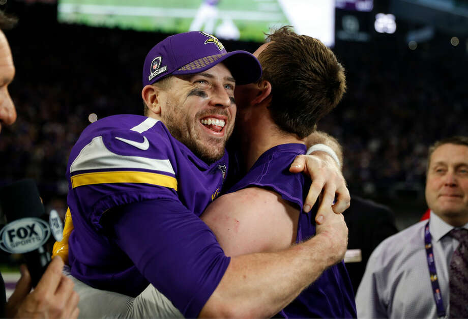 In this Jan. 14, 2018, file photo, Minnesota Vikings quarterback Case Keenum, left, celebrates after a 29-24 win over the New Orleans Saints during the second half of an NFL divisional football playoff game in Minneapolis. (AP Photo/Jeff Roberson, File)