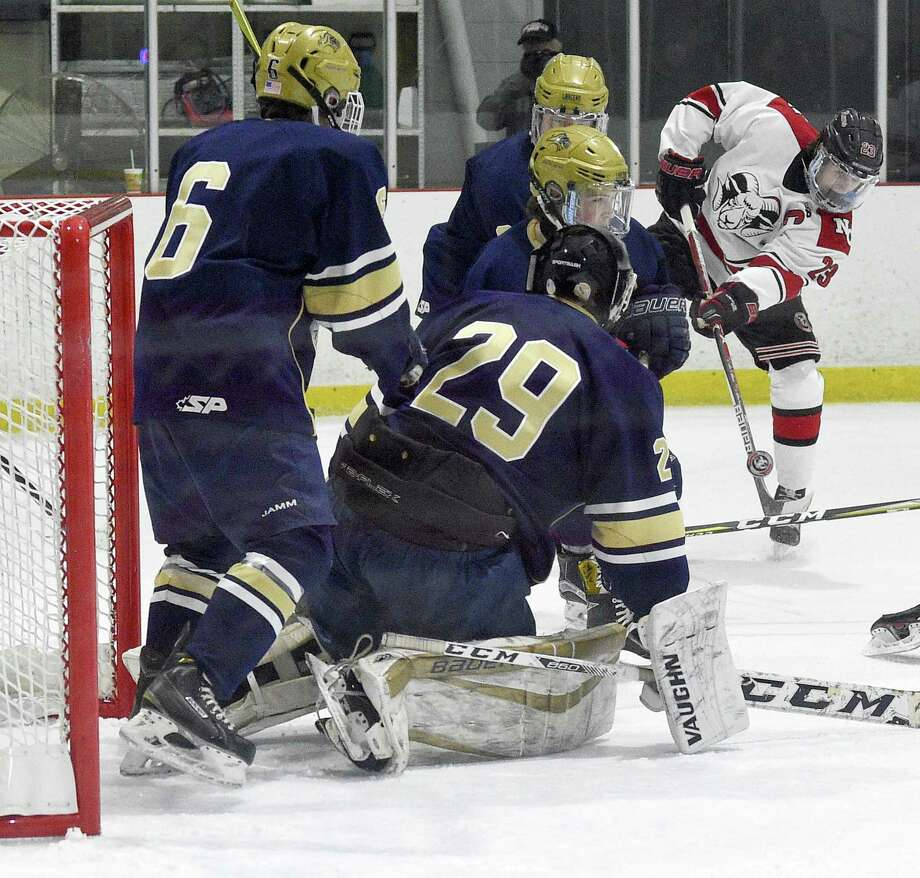 New Canaan Quinn McMahon (23) pops a shot in for a score against Notre Dame-Fairfield goalie Andrew Jones (29) in a FCIAC boys hockey game at the Darien Ice House in Darien, Conn. on Saturday, Jan. 20, 2018. Photo: Matthew Brown / Hearst Connecticut Media / Stamford Advocate