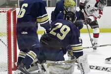 New Canaan Quinn McMahon (23) pops a shot in for a score against Notre Dame-Fairfield goalie Andrew Jones (29) in a FCIAC boys hockey game at the Darien Ice House in Darien, Conn. on Saturday, Jan. 20, 2018.