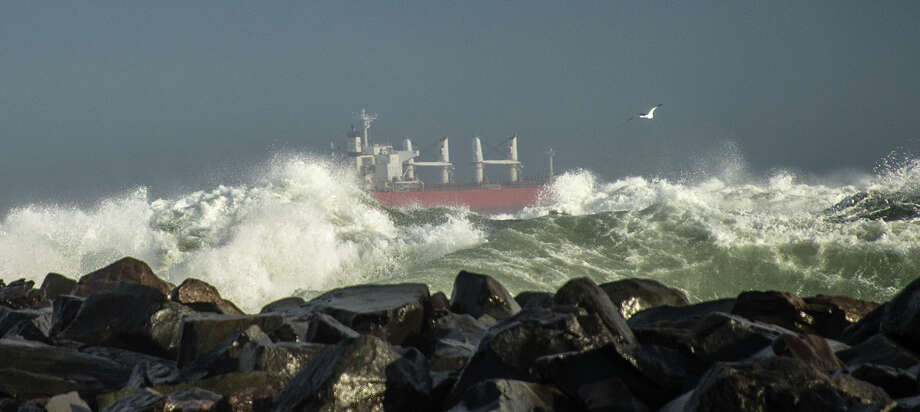 A Cargo Ship is seen in Chehalis Reach of Grays Harbor, taken from North Jetty at Ocean Shores on January 18, 2018. More waves like this could pound Washington's coast Saturday night. Photo courtesy Roy Goodall. Photo: Roy Goodall/Special To The PI