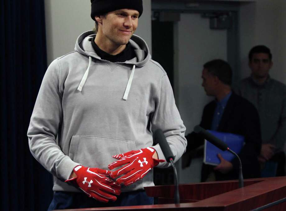 New England Patriots quarterback Tom Brady wears gloves as he arrives to speak to the media on Friday. Register columnist Chip Malafronte says that no matter the outcome on Sunday, the aftermath of 'Golve-gate' will be insufferable. Photo: Bill Sikes / Associated Press / Copyright 2018 The Associated Press. All rights reserved.