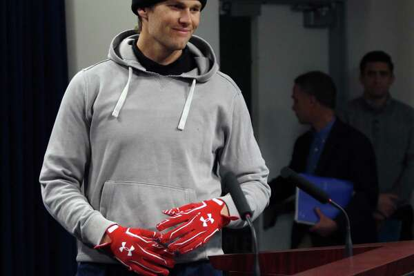 New England Patriots quarterback Tom Brady wears gloves as he arrives to speak to the media on Friday. Register columnist Chip Malafronte says that no matter the outcome on Sunday, the aftermath of 'Golve-gate' will be insufferable.