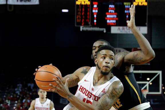 Houston forward Devin Davis drives around Wichita State forward Rashard Kelly during the second half of the Cougars' upset of No. 7 Wichita State.