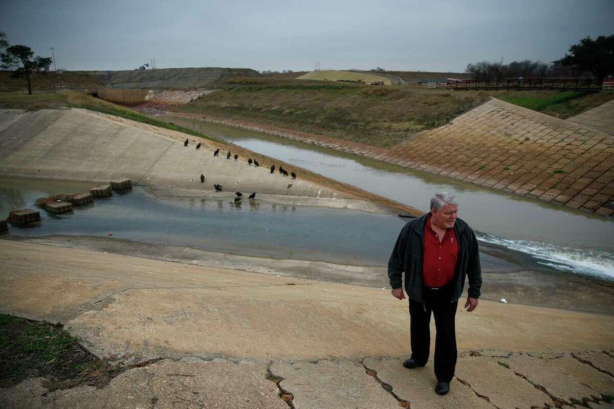 Glen Crocker, former assistant Fort Bend County engineer, checks the Barker Reservoir spillway. His flood fears came true.