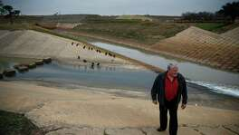 Glen Crocker, former assistant Fort Bend County engineer, checks the Barker Reservoir spillway. His flood fears came true.