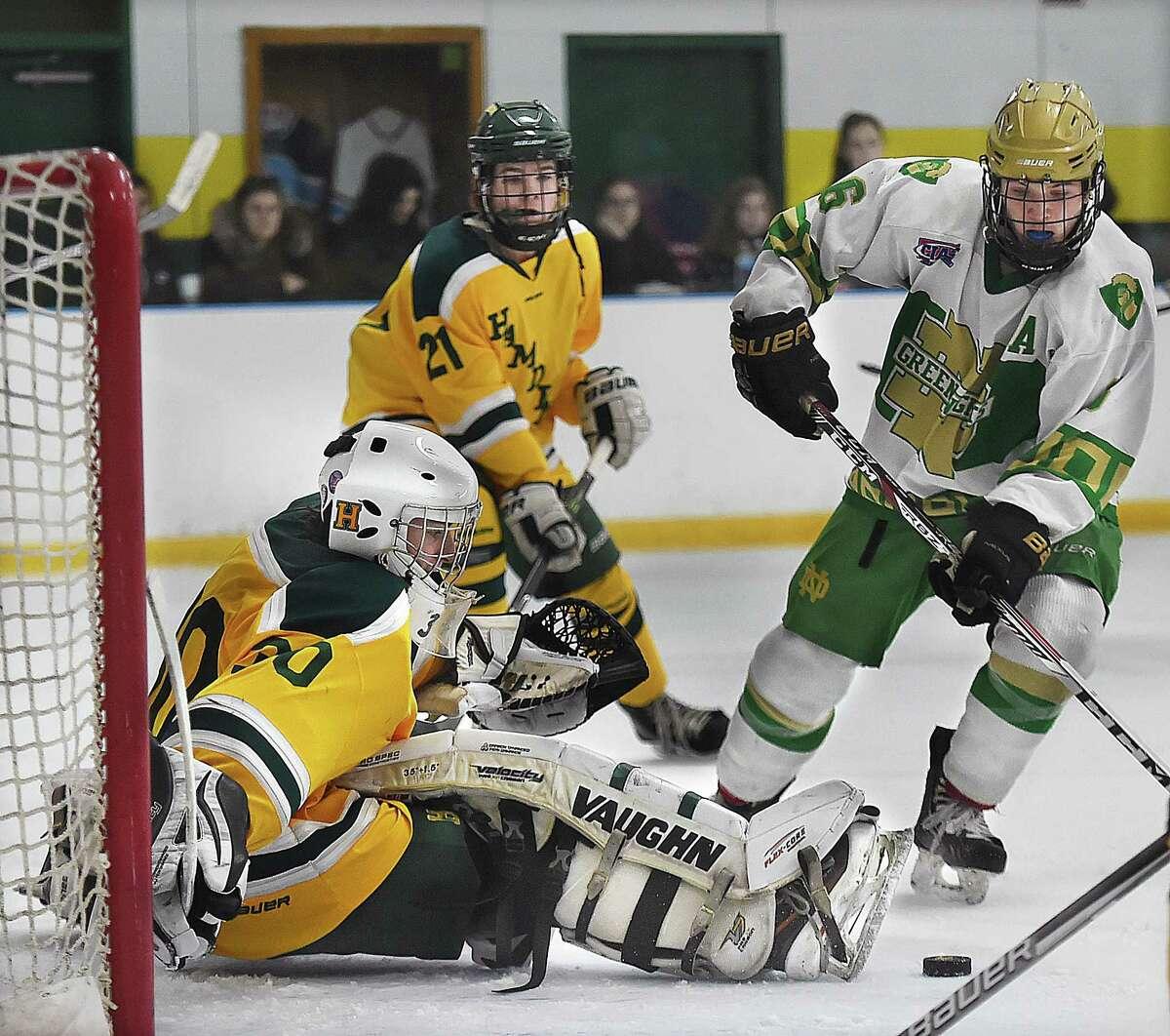 Notre Dame-West Haven defenseman Clay Coassin scores as Hamden goalie Steven Turner attempts to make the save Saturday at Astorino Rink in Hamden.
