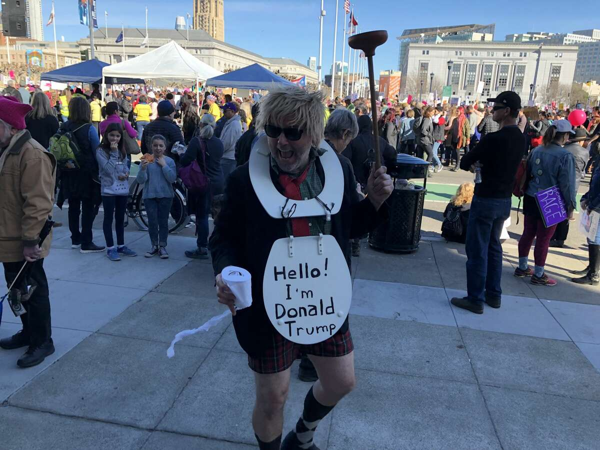 People took to the streets of San Francisco with creative signs for the Women's March on Saturday.