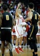 Houston guard Rob Gray (32) holds out his jersey in celebration as the final seconds tick down on their upset win over Wichita State at H&PE Arena at Texas State University Saturday, Jan. 20, 2018, in Houston, TX. (Michael Wyke / For the  Chronicle)