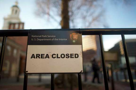 A sign keeps out visitors at the shuttered Independence Hall in Philadelphia after the government shutdown. Some national parks were still accessible Saturday but with limited facilities.