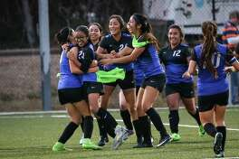 The New Caney Eagles celebrate winning the girls soccer game against College Park on Saturday, Jan. 20, 2018, at the Gosling Sports Complex. (Michael Minasi / Houston Chronicle)