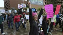 "Ginger Diercks (center) yells, ""This is what democracy looks like,"" as she and Jane Herzig (right) join about 500 people according to organizers gathered at Main Plaza to take part in the second annual Women's Rally on Saturday, Jan. 20, 2018. The message of the event hosted by TX23 Indivisible, was clear and decisive as speaker after speaker implored those in attendance that women's voices were not be silenced and to vote in upcoming elections. ""When women vote, we win,"" said Cassandra Littlejohn, Bexar County Democratic Party Political Director. Toward the end of the two-hour rally, a brief march around Main Plaza came together as the event concluded. (Kin Man Hui/San Antonio Express-News)"