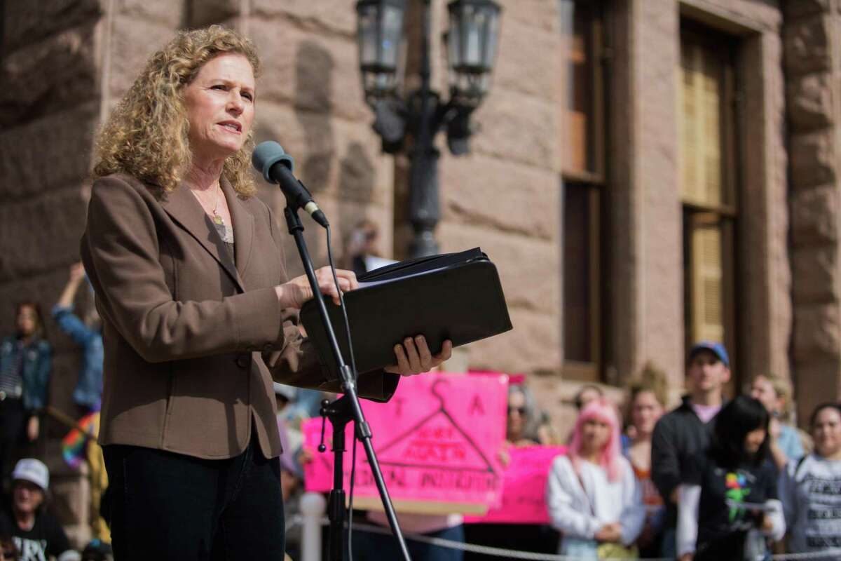 Representative Donna Howard speaks to the crowd during a rally on the South stairs of the capitol in Austin, Texas on January 20, 2018.