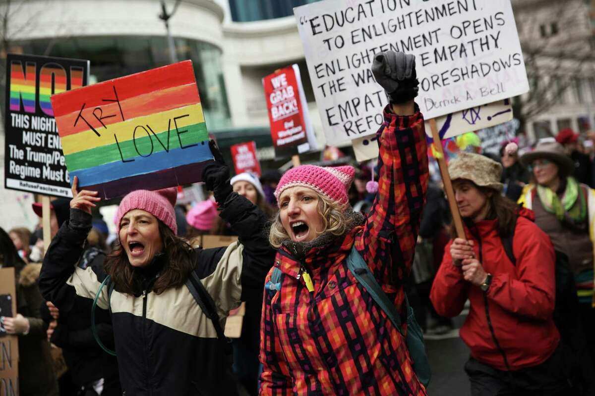 Thousands march through the streets of Seattle, from Cal Anderson Park to the Seattle Center, for the Women's March 2.0, Saturday, Jan. 20, 2018. Demonstrators came out in support of women's right and immigrant rights and against President Trump's administration.