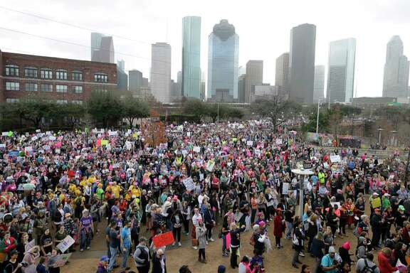 Thousands gather at Water Works at Buffalo Bayou for the Houston Women's March to City Hall on Saturday. The march was one of more than 200 planned across the country and attracted an estimated 20,000 participants, according to the march's founder.