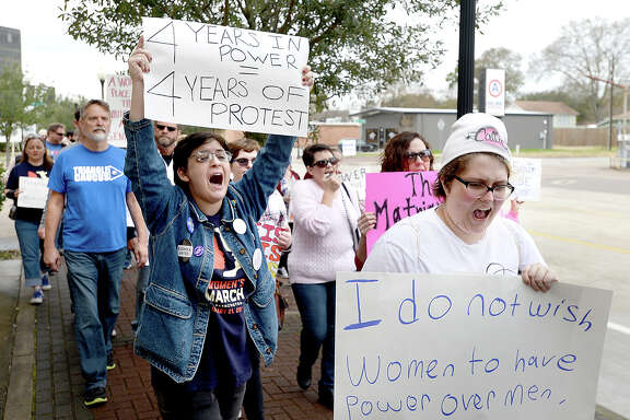 Marchers chant as they make their way up Calder Avenue during the Women's March hosted by Golden Triangle Indivisible in Beaumont Saturday. The event is one of many taking place throughout the nation, following in the footsteps of last year's marches. The march aims to unite the community in support of women's rights and equality. Photo taken Saturday, January 20, 2018 Kim Brent/The Enterprise