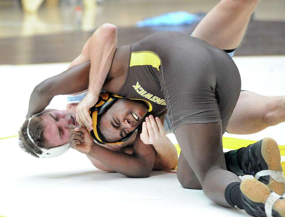 Nadji Ngbokoli (brown singlet) of Brunswick School in the 145 pound match that he won against Alec Nevin of Northfield Mount Herman during the Brunswick School Invitational Wrestling Tournament at the School in Greenwich, Conn., Saturday, Jan. 20, 2018. Photo: Bob Luckey Jr. / Hearst Connecticut Media / Greenwich Time