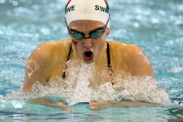 The Woodlands' Lillie Nordmann competes during District 13-6A swim meet at Conroe ISD Natatorium, Saturday, Jan 20, 2018, in Shenandoah.