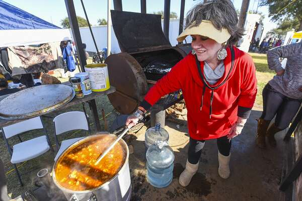 Minerva Saenz stirs a pot of menudo on Saturday, Jan. 20, 2018 at the Laredo International Fair and Exposition Grounds during the 23rd Annual Menudo Bowl.