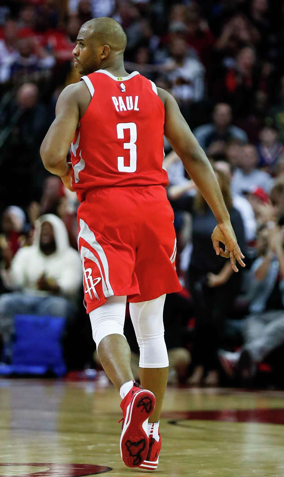 Houston Rockets guard Chris Paul (3) runs back up court after hitting a 3-pointer during the second quarter of an NBA basketball game against the Golden State Warriors at Toyota Center on Saturday, Jan. 20, 2018, in Houston.