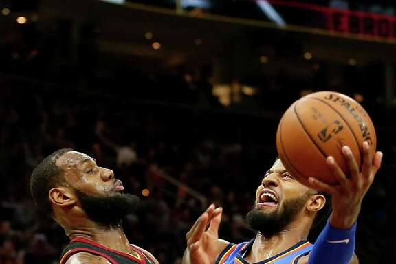 Cleveland's LeBron James, left, finished with 18 points in a blowout loss to Oklahoma City in which the Cavs allowed the team's most points in regulation since 1972.