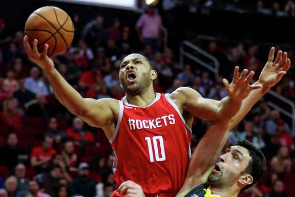 Eric Gordon drives to the basket against Golden State's Zaza Pachulia during the first quarter at Toyota Center on Saturday. Gordon will defend his 3-point shooting title at the NBA's All-Star Weekend next month.