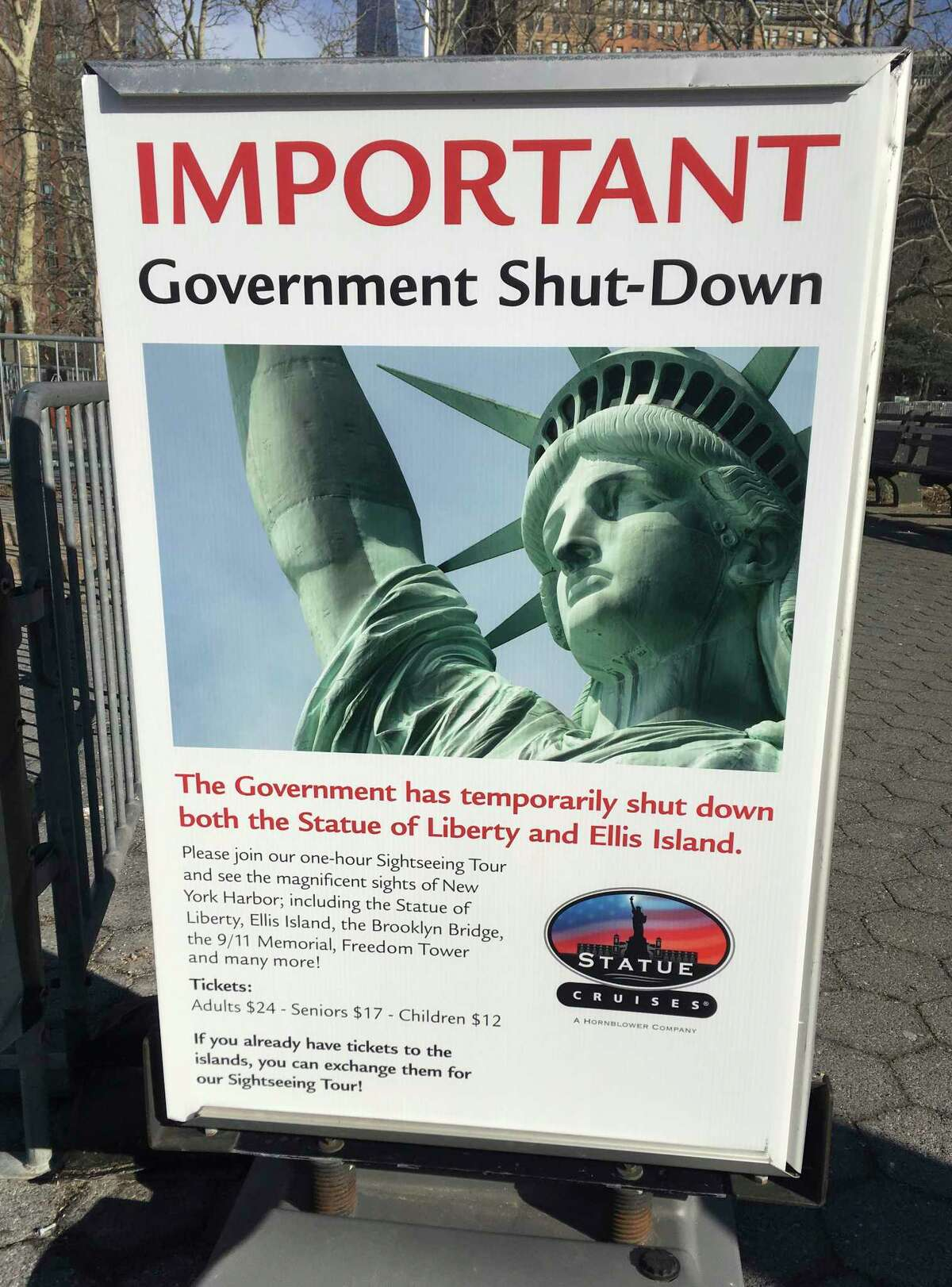 The sign at the Ellis Island ferry cue informs visitors that there was no access to the island or to the Statue of Liberty, due to the government shutdown, Saturday, Jan. 20, 2018 in New York. When a dispute in Congress over spending and immigration forced scores of federal government agencies and outposts to close their doors, the Statue of Liberty and Ellis Island had to turn away visitors, due to what the National Park Service described as